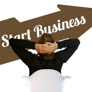 photo-of-man-and-start-business-sign
